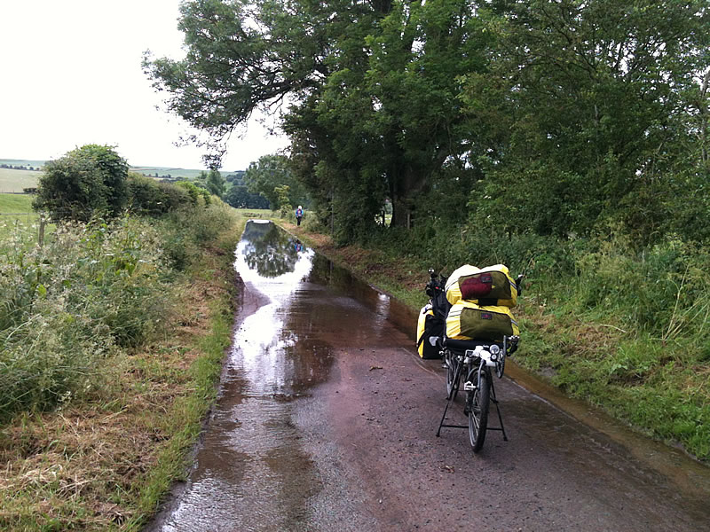 Flooded lane. Time to kick Karon out of the 'Princess' seat and move the low bags up out of the water.